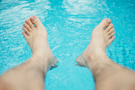 body scape: Chilling feet over the pool Stock Photo