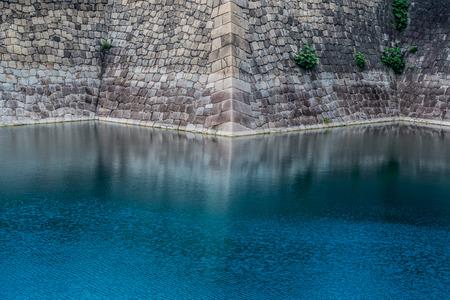 gentleness: Strength of the wall VS gentleness of water Stock Photo