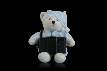 cubby: bear and  camera on black background Stock Photo