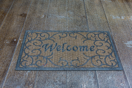 welcome mat: Vintage Welcome mat on wood floor Stock Photo