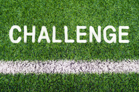 Challenge hand writing on soccer field photo