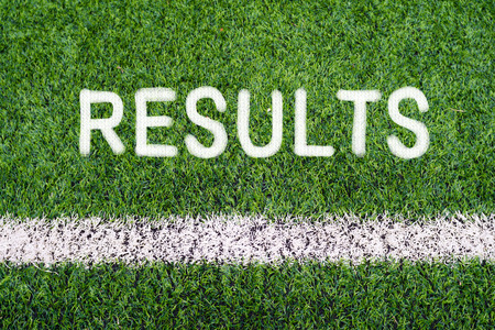 RESULTS hand writing text on soccer field grass photo