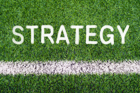 STRATEGY hand writing text on soccer field grass photo