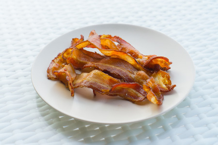 mouth watering: Cooked Greasy Bacon on white plate