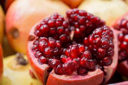 medium close up: Juicy pomegranates close up