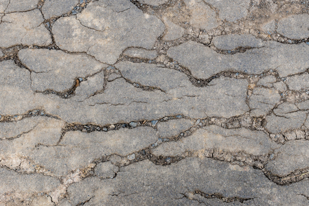 crazed: Macro closeup on concrete asphalt cracks on the road Stock Photo
