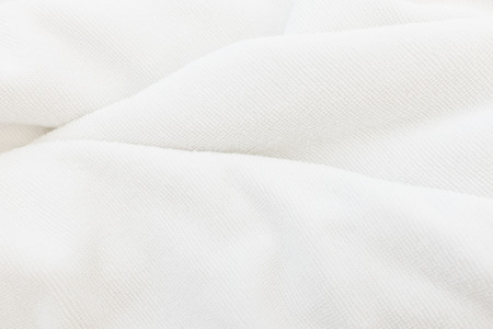 white towel: White cotton towel close up background texture