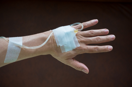 saline solution: back hand with saline solution with strong vignette
