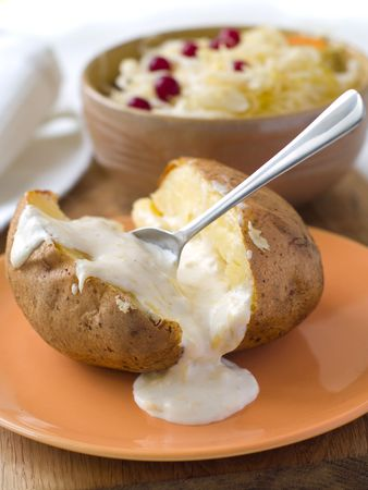 Baked potato with sauce and cabbage photo