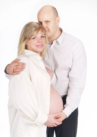 Pregnant woman poses with her husband . Not a young pair photo