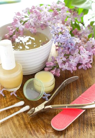 Device for manicure. Lilac on background. Could be a generic toiletry. photo