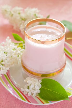 Dairy cocktail in the glass, decorated with flowers. On a pink background Stock Photo - 7064985