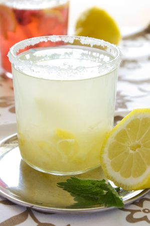 cold fresh lemonade drink with mint close up photo