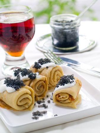 pancakes with black caviare and sour cream Stock Photo - 7282427