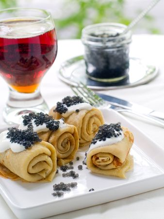 pancakes with black caviare and sour cream Stock Photo - 7282427