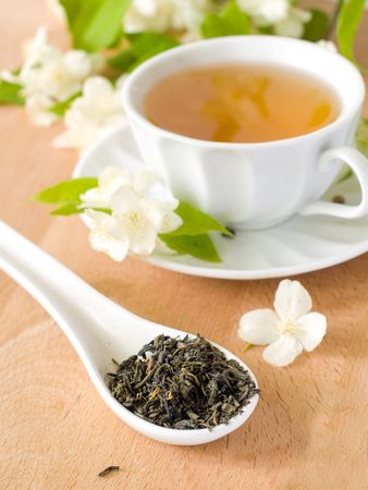 Organic jasmine tea with fresh jasmine flowers.  photo