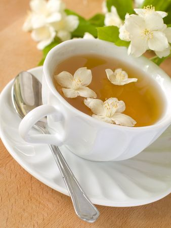 Organic jasmine tea with fresh jasmine flowers.  photo