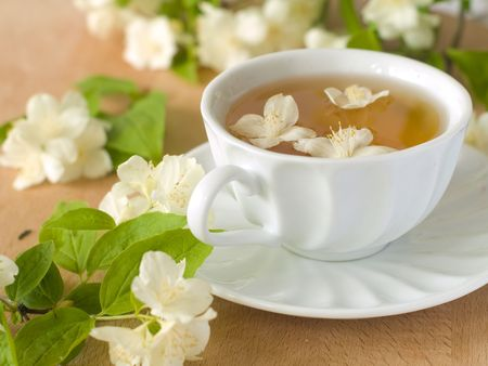 Organic jasmine tea with fresh jasmine flowers.