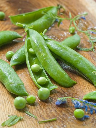 Fresh garden peas pods and flowers photo