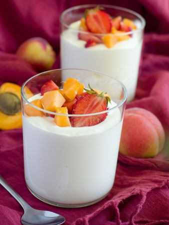Yogurt with apricots  and strawberries for   breakfast