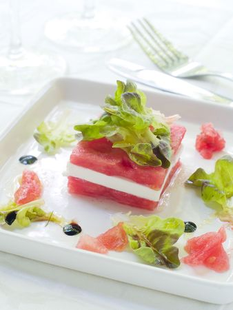 Appetizer from lettuce, watermelon and feta in cup photo