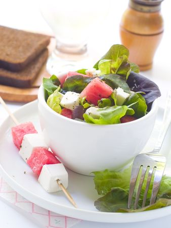 Salad from watermelon, lettuce and feta in cup photo
