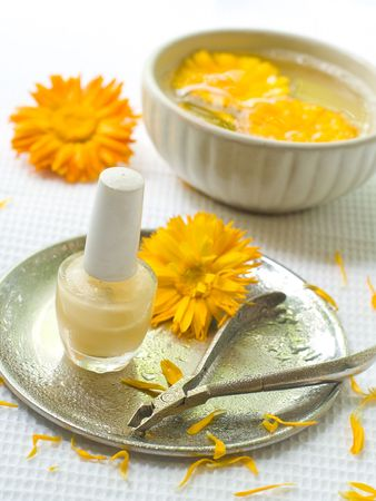 toiletry: Device for manicure. Yellow Chamomile on background. Could be a generic toiletry. Stock Photo