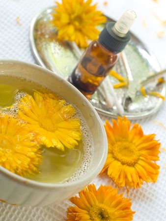 toiletry: bowl of water with yellow flower. Device for manicure on background. Could be a generic toiletry. Stock Photo
