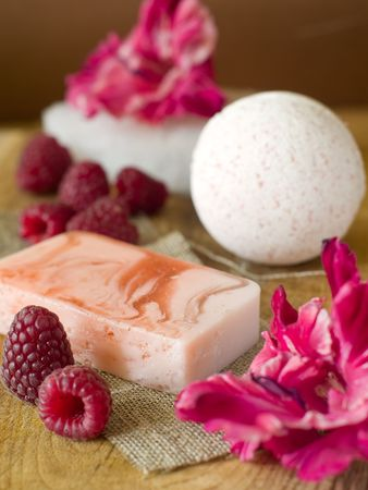 bar of natural handmade soap, surrounded by fresh ingredients photo