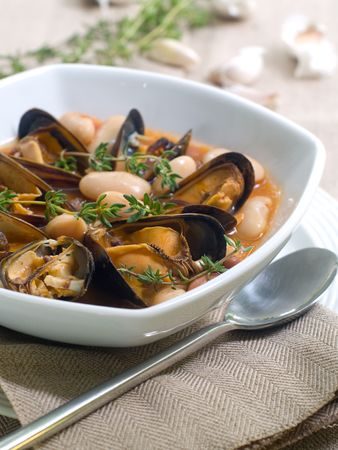 mussel soup with bean and thyme on bowl Stock Photo - 7800219