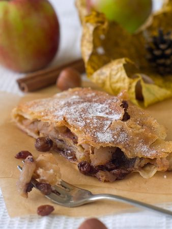 slice of an apple strudel on a baking paper photo