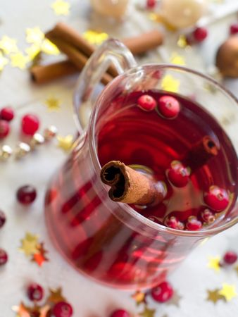 Hot drink with cranberries and cinnamon photo