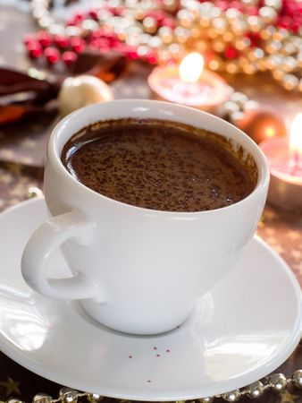 Closeup view of cup of coffee with chocolate photo