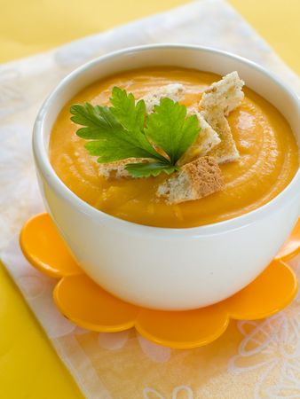 Delicious and creamy pumpkin soup in bowl