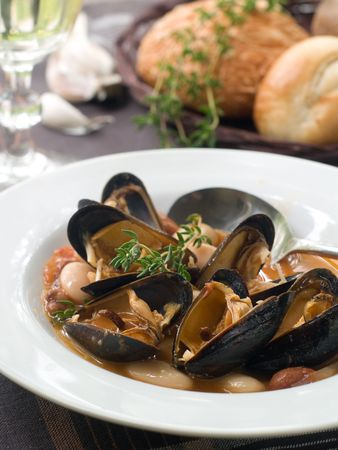 mussel soup on bowl with white wine Stock Photo - 8093054