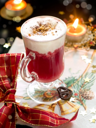 Hot winter drink with cream. Christmas decoration on background photo