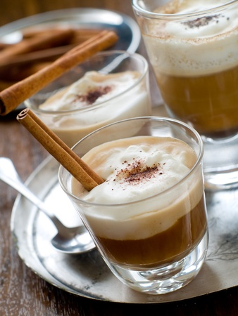 cafe latte: Cafe Latte in glasses with cinnamon stick  on plate