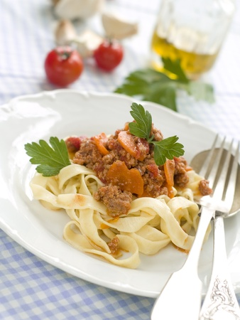 Pasta with meat sauce and parsley photo