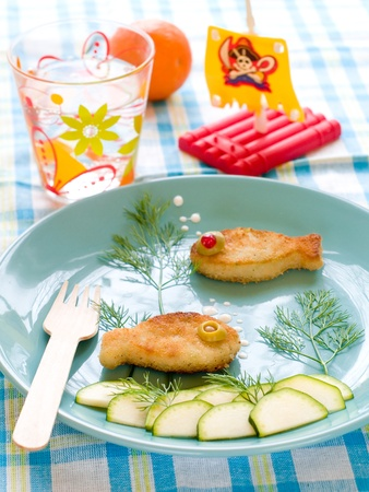 Roasted fish  with fresh cucumber for childs dinner photo