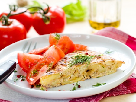 Delicious omelet with vegetable and tomato salad for breakfast