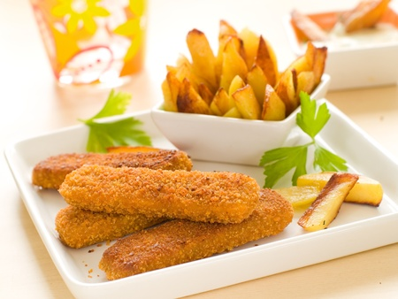 american cuisine: Fish sticks and fried potato on white plate