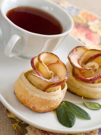 Apple cakes with cup of tea like flower photo