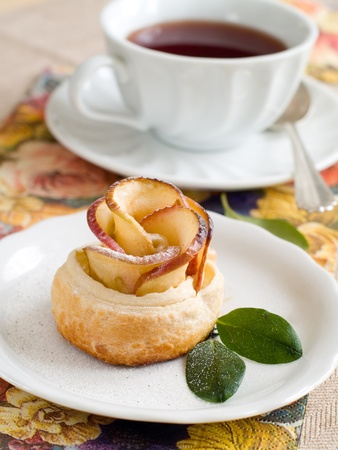 Apple cake with cup of tea like flower photo