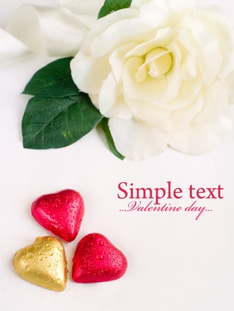 Three chocolate hearts with white flower on background Stock Photo - 8625574