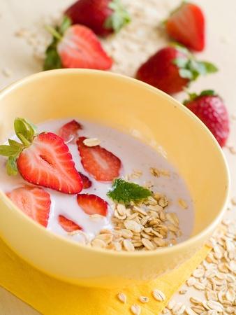 Yogurt breakfast with strawberry and oatmeal photo
