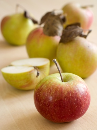 fresh harvested apples on wooden board Stock Photo - 8981354