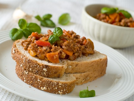 sloppy: Sandwich of savory ground beef on  wholewheat bread. A delicious variety of a Sloppy Joe.  Stock Photo