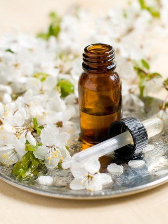 traquility: bottle of essential oil with cherry blossom