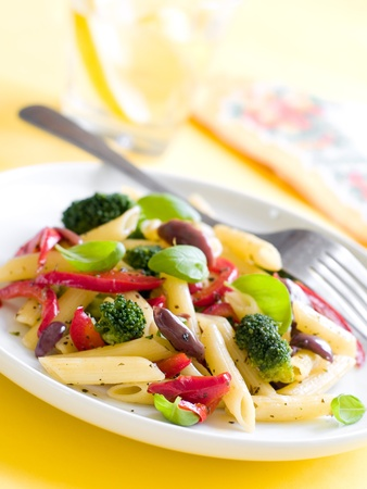 tészta:  pasta with pepper,broccoli and  olive close up. Selective focus Stock fotó