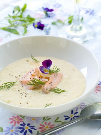 chowder: A bowl of creamy soup with salmon. Shalow depth, selective focus